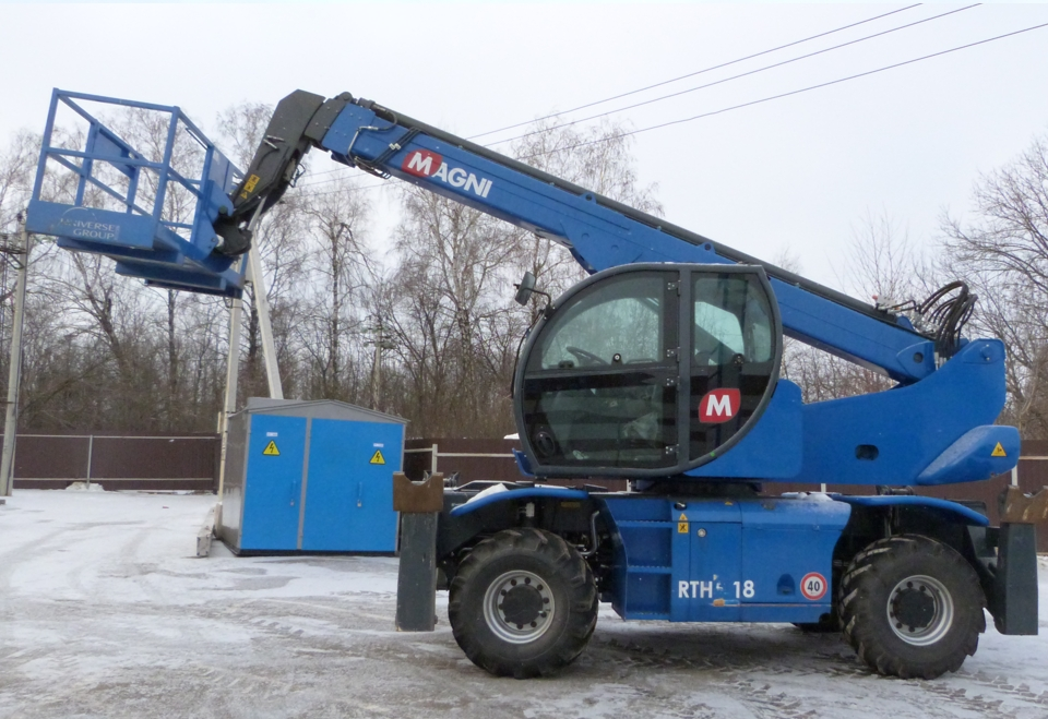 Blue rotated telescopic handler MAGNI RTH 5.18 for hire